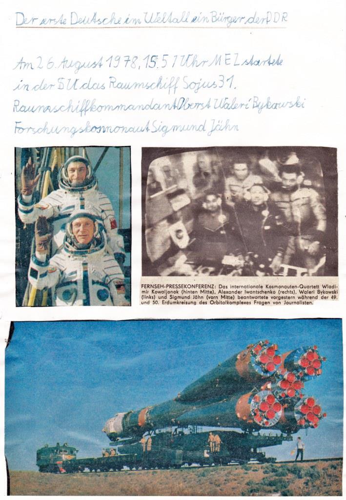 Zeitungsartikel mit den Kosmonauten und der Rakete